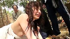Slutty Asian bride fucked by a group of guys in the outdoors